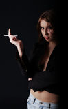 Portrait of young girl with a cigarette stock photos