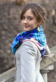 Portrait of the young girl in a coat and a scarf Stock Image