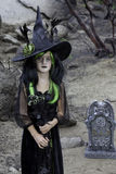 Portrait of young girl costumed as a witch Stock Photo