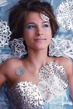 Portrait of young girl with cut snowflakes Stock Photo