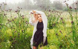Portrait of young girl dancing in chamomile field Stock Photos