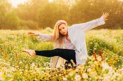 Portrait of young girl dancing in chamomile field Royalty Free Stock Image