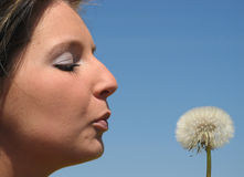 Portrait of a young girl with dandelion Royalty Free Stock Photography