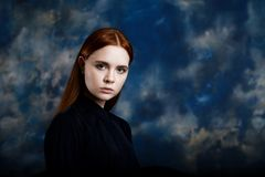 Portrait of a young girl on dark background Stock Photos