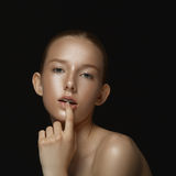 Portrait of a young girl on a dark background. Stock Image