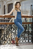 Portrait of a young girl in denim overalls Royalty Free Stock Photo