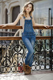 Portrait of a young girl in denim overalls Royalty Free Stock Photography