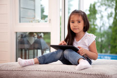 Portrait of Young Girl with Digital Tablet Royalty Free Stock Image