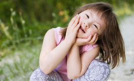 Portrait of young girl with down syndrome stock photo