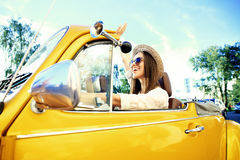 Portrait of Young girl driving cabriolet at sunset royalty free stock photography