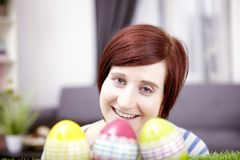 Portrait of young girl with easter eggs Stock Photography