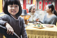 Portrait of young girl at family meal Royalty Free Stock Photos