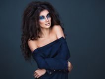 Portrait of a young girl with a fashion dark  makeup of eyes and Stock Photos