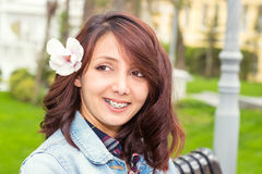 Portrait of young girl with flower in hair. Portrait of young girl with braces outdoor Royalty Free Stock Photo
