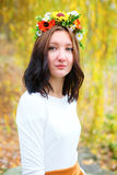 Portrait young girl with flower wreath Stock Photos