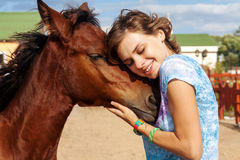 Portrait of young girl with a foal Royalty Free Stock Photography