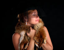 Portrait of young girl with fox fur wrapped around Royalty Free Stock Images