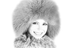 Portrait of young girl in furry hat Royalty Free Stock Images