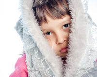 Portrait of young girl with furry hood Royalty Free Stock Images