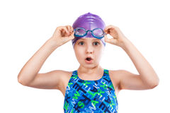 Portrait of a young girl in goggles and swimming cap. Royalty Free Stock Photography