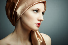 Portrait of the young girl with golden scarf on head Stock Images