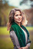 Portrait of a young girl with  green scarf on the background  autumn park Royalty Free Stock Photo