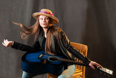 Portrait of young girl with guitar Royalty Free Stock Photo