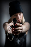 Portrait of a young girl with a gun Royalty Free Stock Photography