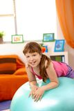 Portrait of young girl with gym ball Royalty Free Stock Images