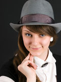 Portrait young girl in hat. Coquettish pretty young girl in hat looks Royalty Free Stock Photos