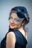 Portrait of the young  girl in hat with veil. Royalty Free Stock Photos