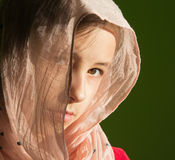 Portrait of young girl in the headcloth. The portrait of young girl in the headcloth Royalty Free Stock Photography