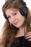 Portrait of young girl in headphones. Young attractive woman in big closed DJ stereo headset Royalty Free Stock Image
