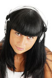 Portrait of the young girl in headphones Royalty Free Stock Images