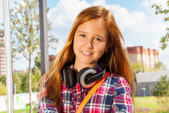 Portrait of young girl with headphones Stock Images