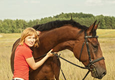 Portrait of young girl  with her horse Royalty Free Stock Images