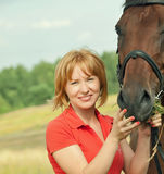 Portrait of young girl  with her horse Stock Photos