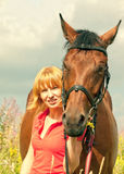 Portrait of young girl  with her horse Royalty Free Stock Photos