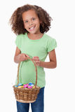 Portrait of a young girl holding a basket full of Easter eggs Stock Images