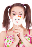Portrait of young girl holding big lollipop Royalty Free Stock Photo