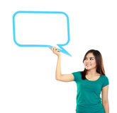 Portrait of young girl holding blank text bubble in specs. Isolated over white background Stock Images