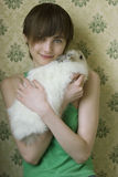 Portrait of a young girl holding a bunny outside Stock Photos