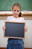 Portrait of a young girl holding at a school slate Stock Image