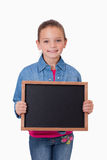 Portrait of a young girl holding a school slate Stock Photos