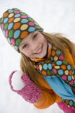 Portrait of young girl holding snowball Royalty Free Stock Photography