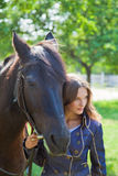 Portrait of a young girl with a horse. Royalty Free Stock Image
