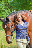 Portrait of a young girl with a horse. Stock Photos