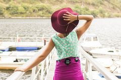 Young girl at the Jetty on summer vacation Stock Images