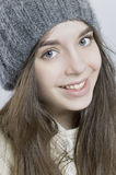Portrait of a young girl in a knitted hat. 