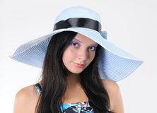 Portrait young girl in a lady's hat Stock Photography